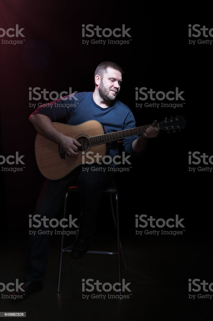 Portrait of a bearded man with guitar stock photo
