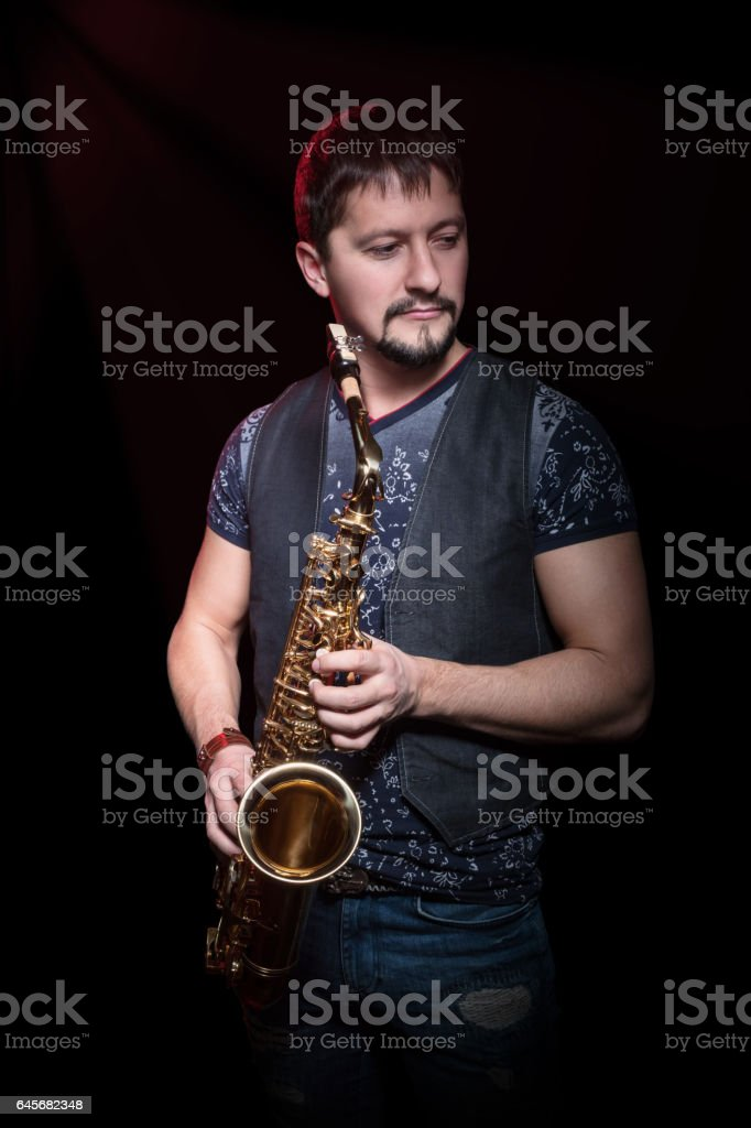 Portrait of a bearded saxophonist stock photo