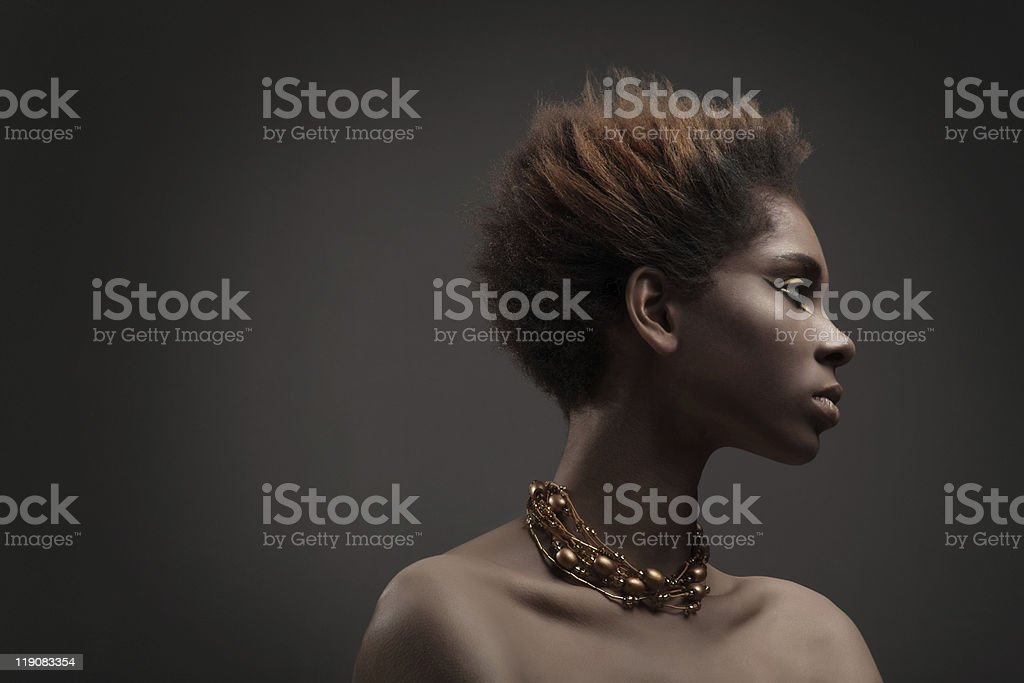 Portrait of a beautiful African woman wearing a necklace stock photo