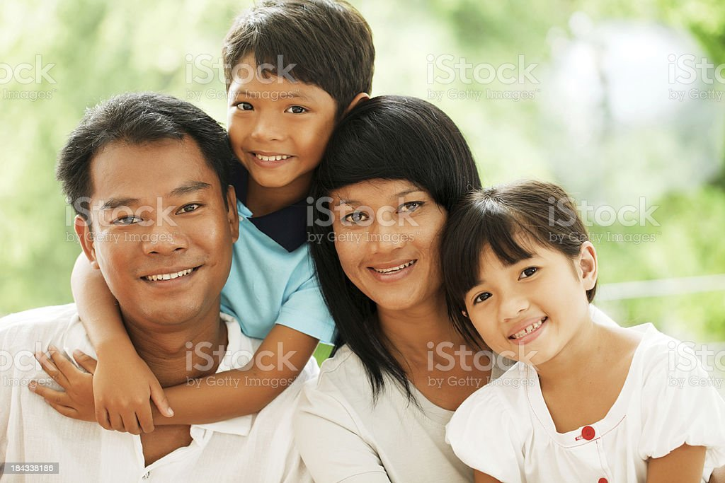 Portrait of a beautiful Asian family. royalty-free stock photo