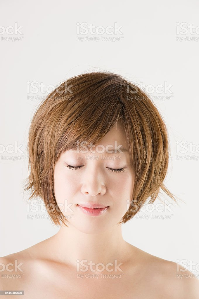 Portrait of a Beautiful Asian Woman with Closed Eyes royalty-free stock photo