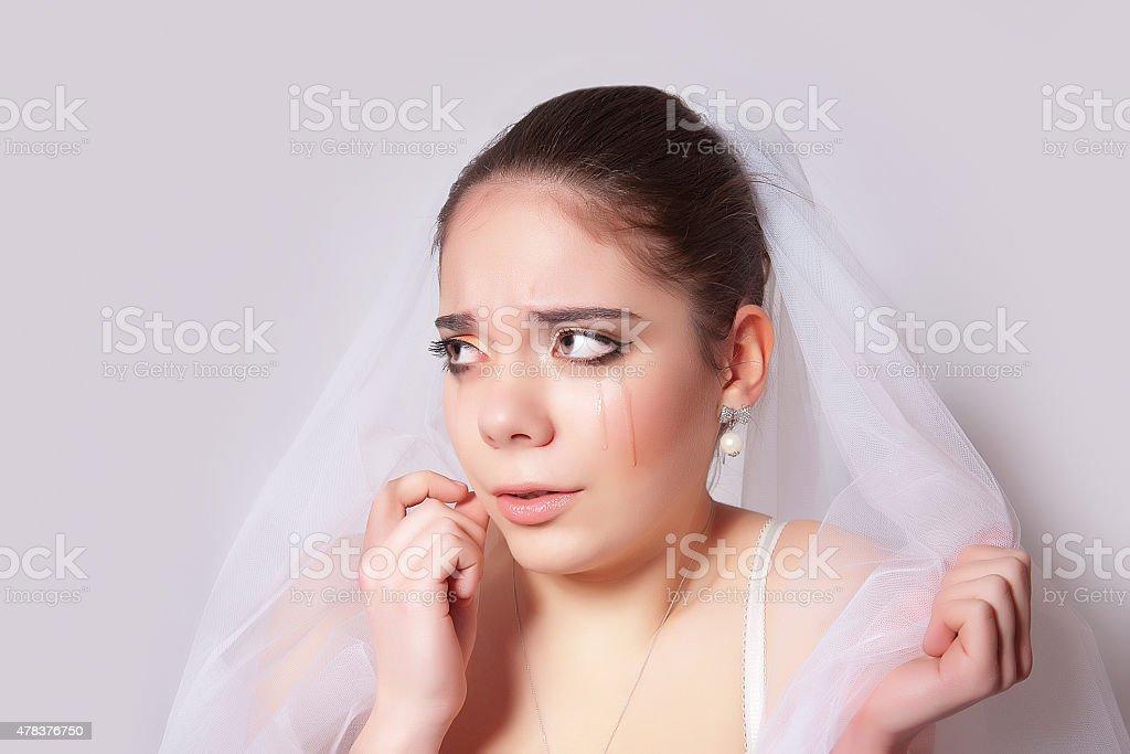 Portrait of a beautiful bride crying, closeup stock photo