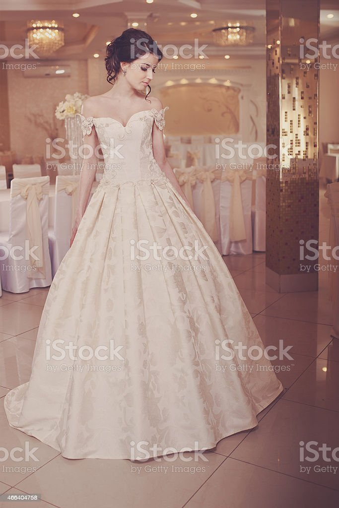 Portrait of a beautiful bride in her off white dress stock photo