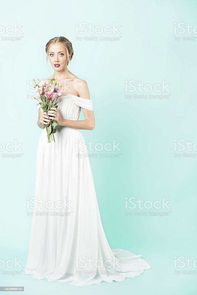 Portrait of a beautiful bride with bouquet. stock photo