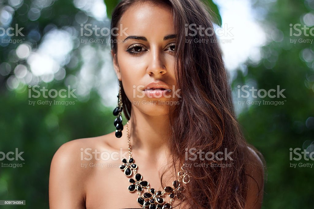 Portrait of a beautiful brunette girl in  summer stock photo