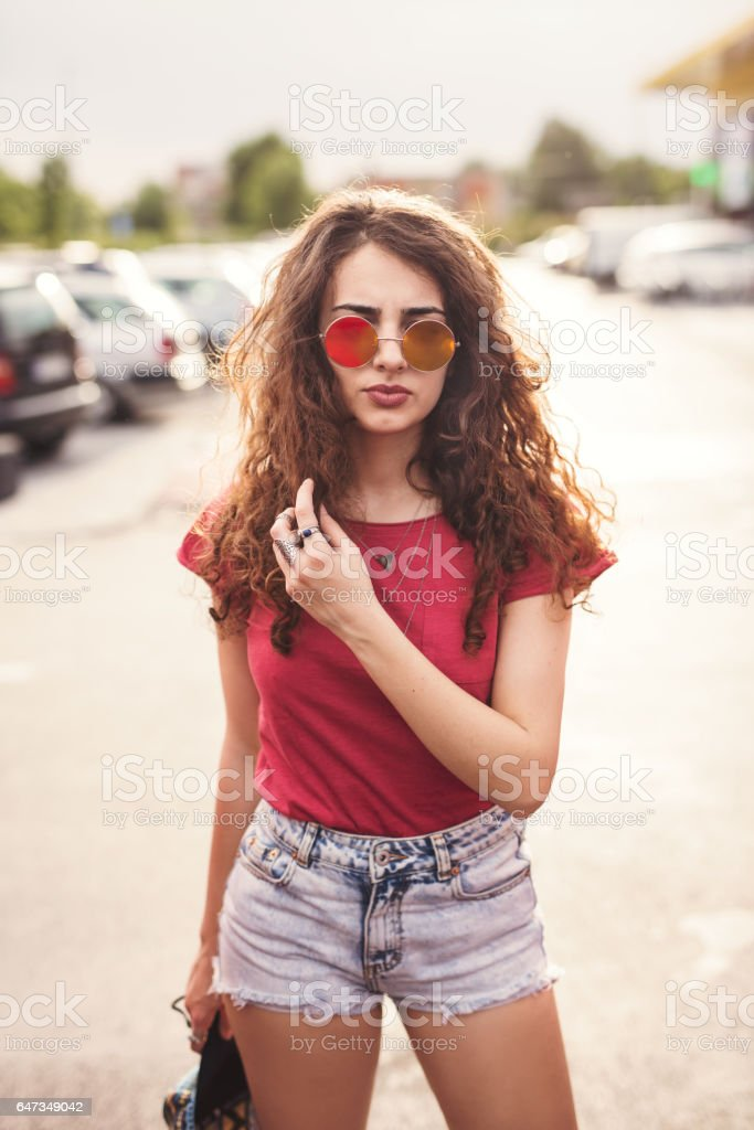 Portrait of a beautiful brunette girl outdoors, lifestyle stock photo