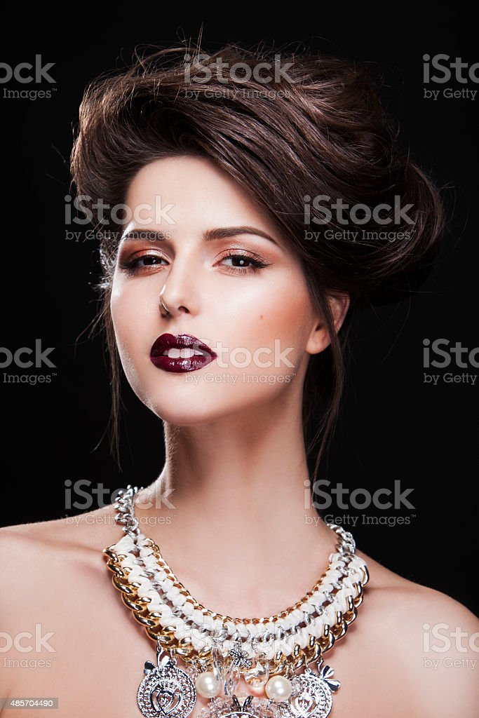 portrait of a beautiful brunette girl with luxury accessories. fashion stock photo