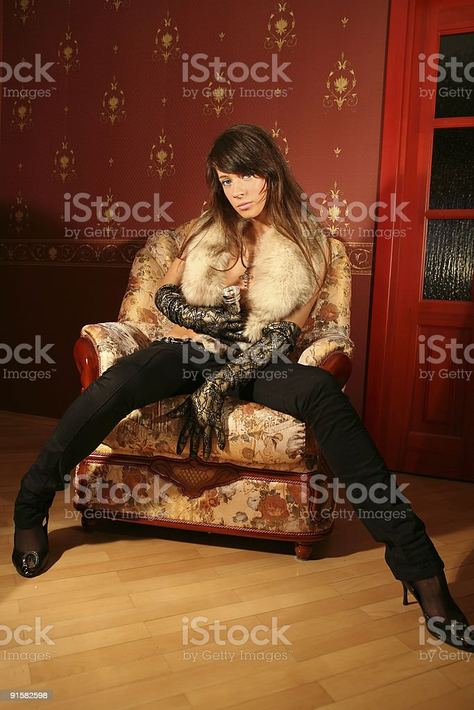 Portrait of a beautiful brunette on luxury armchair. royalty-free stock photo