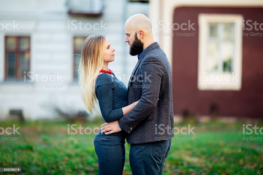 Portrait of a beautiful couple walking on the street royalty-free stock photo