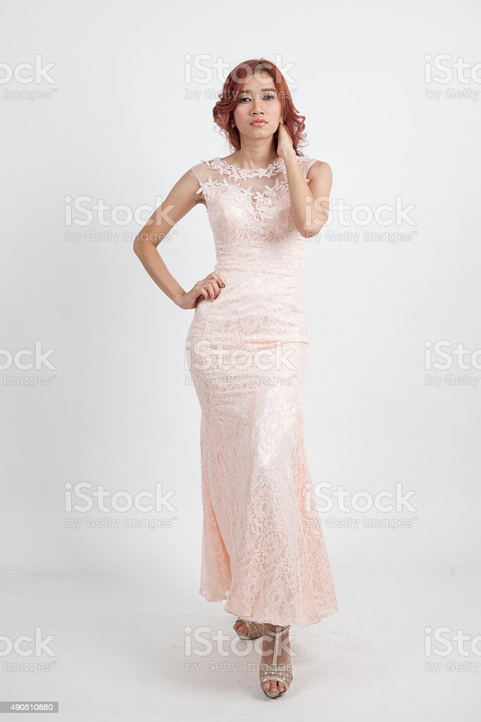 portrait of a beautiful girl in a light pink dress stock photo