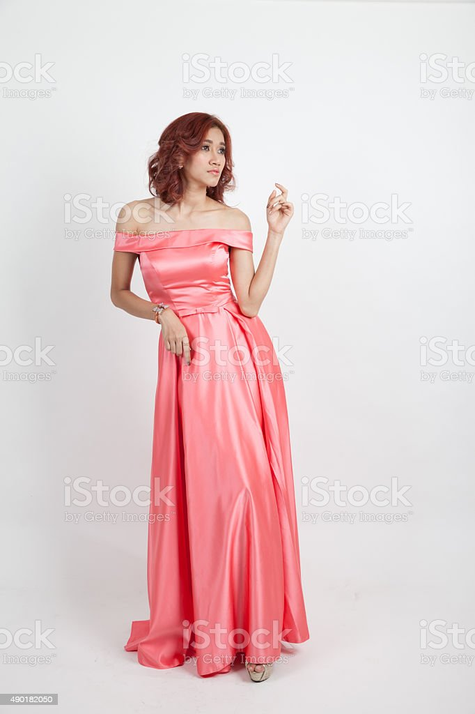 portrait of a beautiful girl in a red dress stock photo