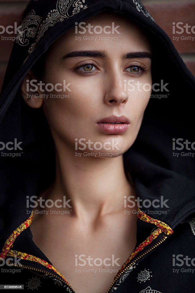 portrait of a beautiful  girl in the hood closeup. royalty-free stock photo