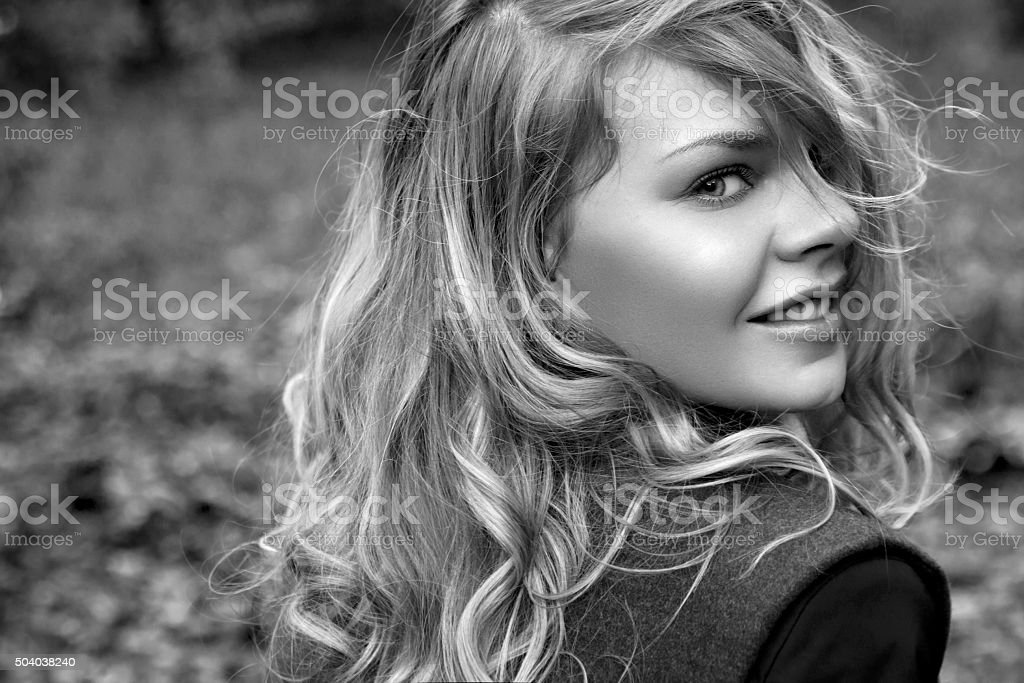 portrait of a beautiful girl in the park stock photo