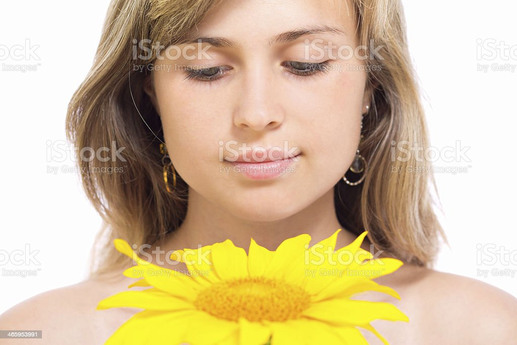 Portrait of a beautiful girl looking at sunflower royalty-free stock photo