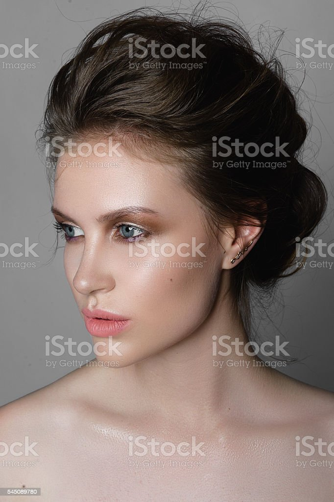 Portrait of a beautiful girl nude make-up stock photo