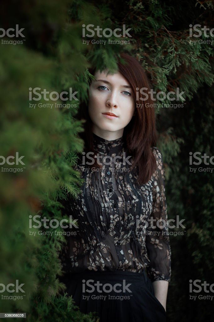 Portrait of a beautiful girl outdoors stock photo