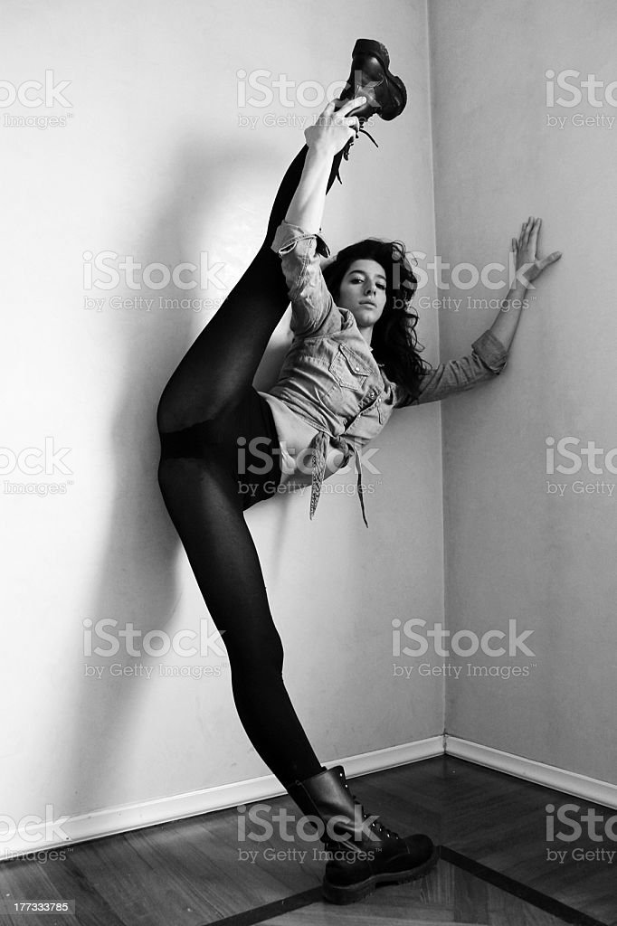 portrait of a beautiful girl stretching her legs royalty-free stock photo