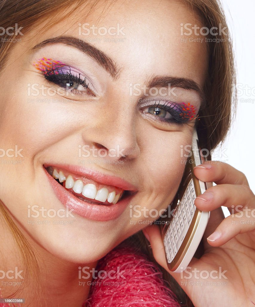 Portrait of a beautiful girl talking on the phone royalty-free stock photo