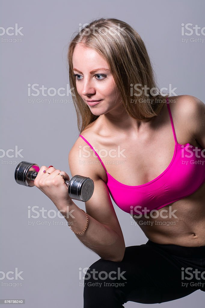 Portrait of a beautiful girl with dumbbell stock photo