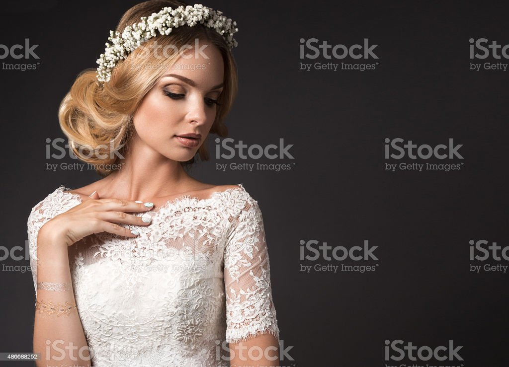 Portrait of a beautiful girl with flowers on her hair stock photo