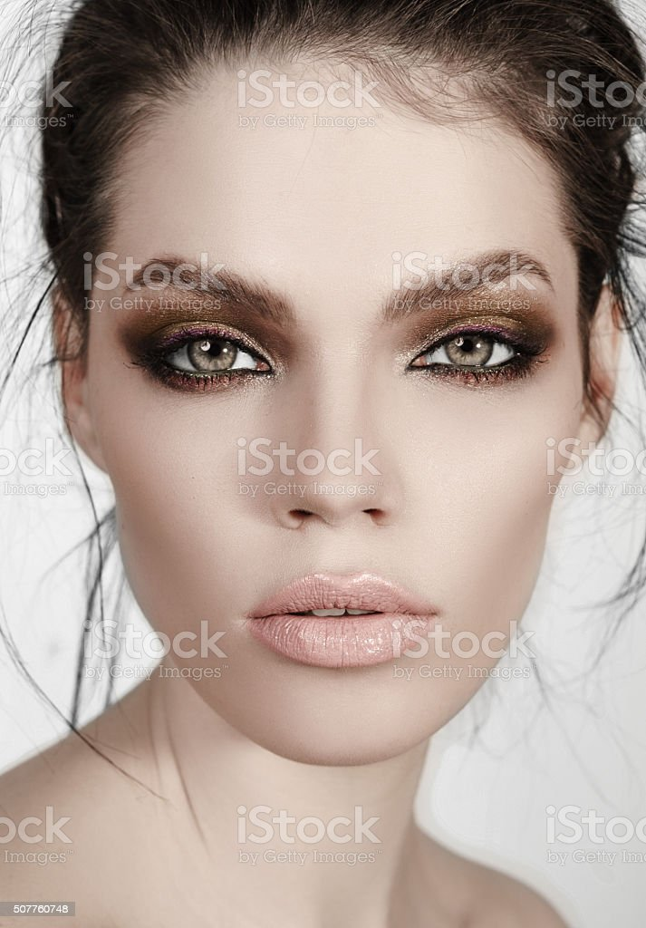 Portrait of a beautiful girl with high-fashion make-up stock photo