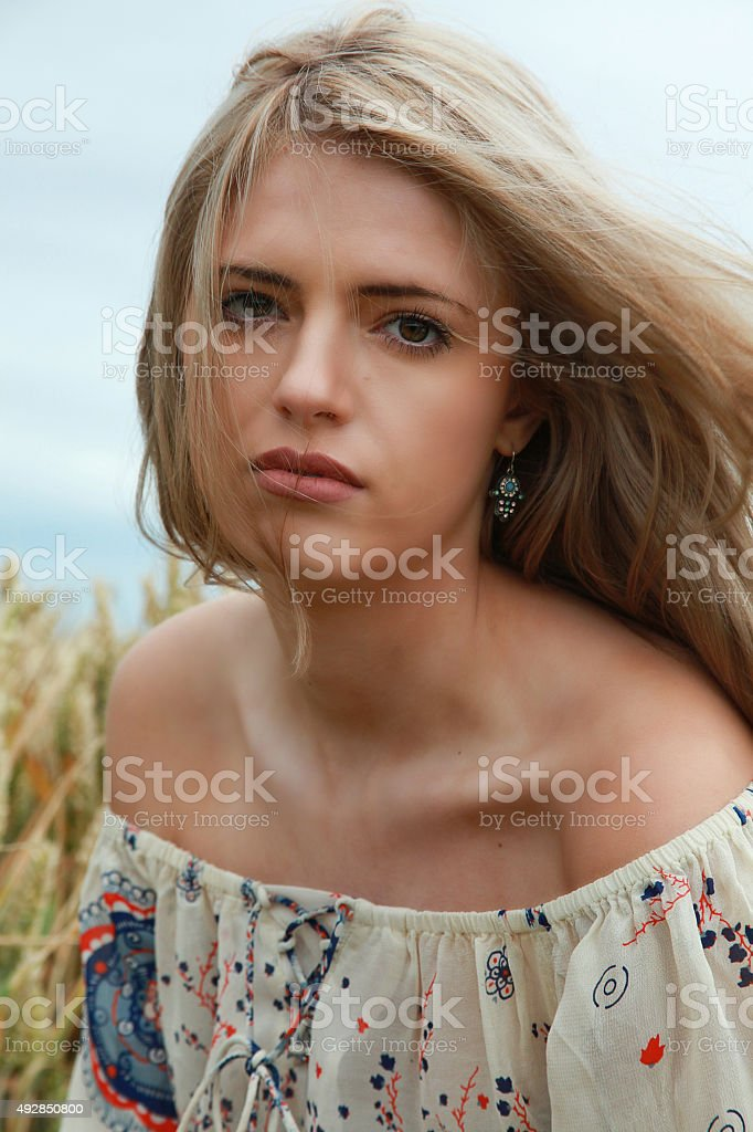 portrait of a beautiful girl with long blonde hair stock photo
