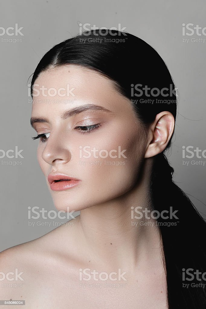 Portrait of a beautiful girl with nude make-up stock photo