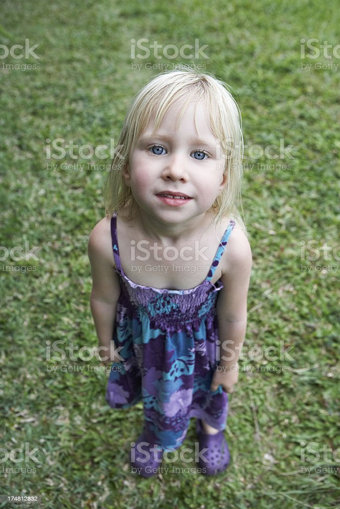 Portrait of a beautiful little girl in nature stock photo