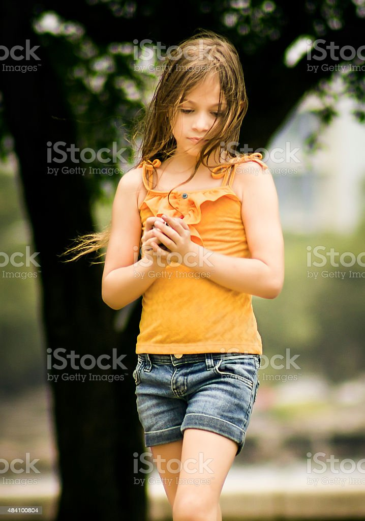 Portrait of a Beautiful Little Girl Playing in Park stock photo