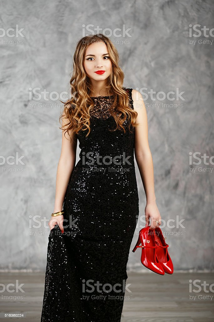 Portrait of a beautiful long-haired young girl in black cocktail stock photo