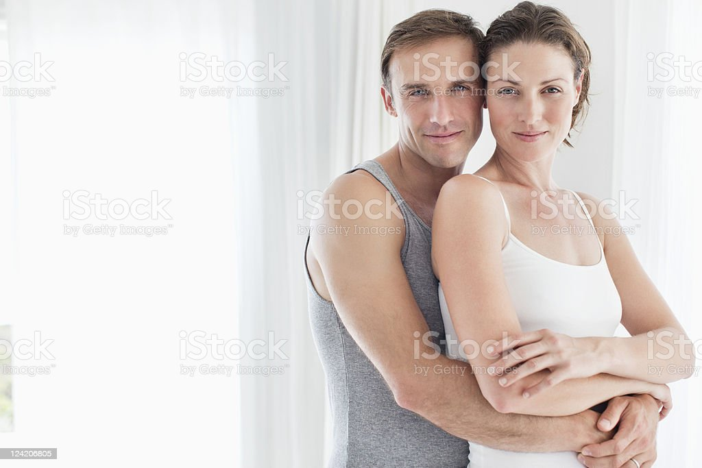Portrait of a beautiful mid adult couple embracing royalty-free stock photo