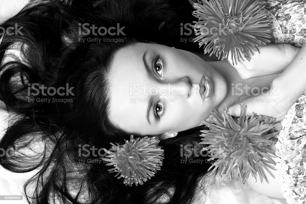 Portrait of a beautiful model in flowers b&w royalty-free stock photo