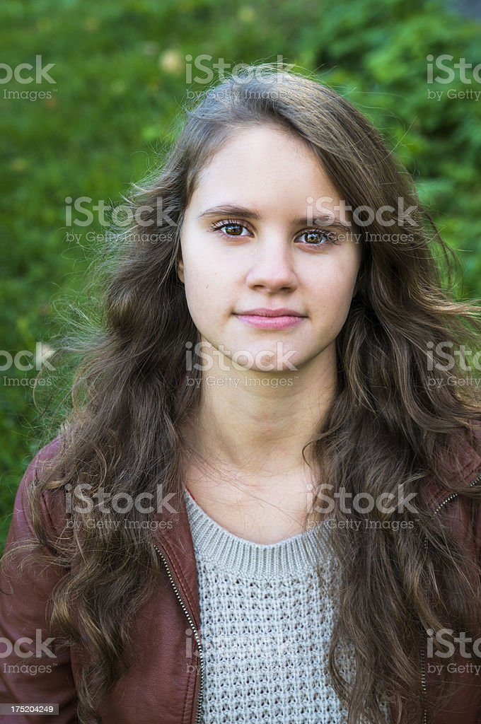 Portrait of a beautiful natural girl, outdoors, vertical. royalty-free stock photo