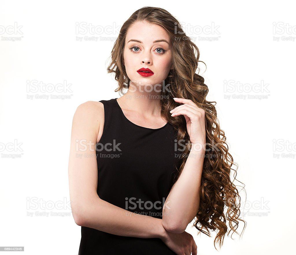 Portrait of a beautiful sensuality woman with curly hair stock photo