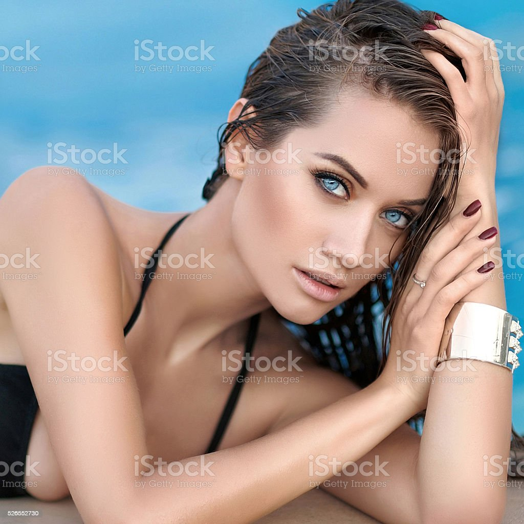 portrait of a beautiful sexy woman in the pool stock photo