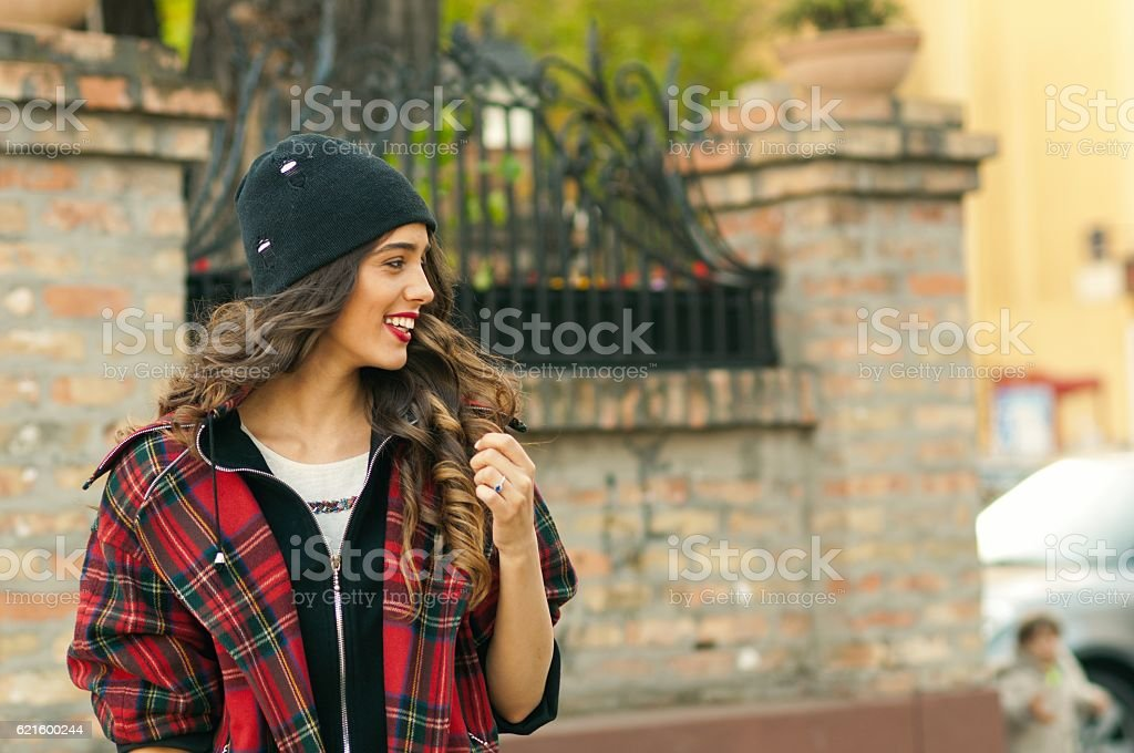 Portrait of a beautiful smiling woman looking away stock photo
