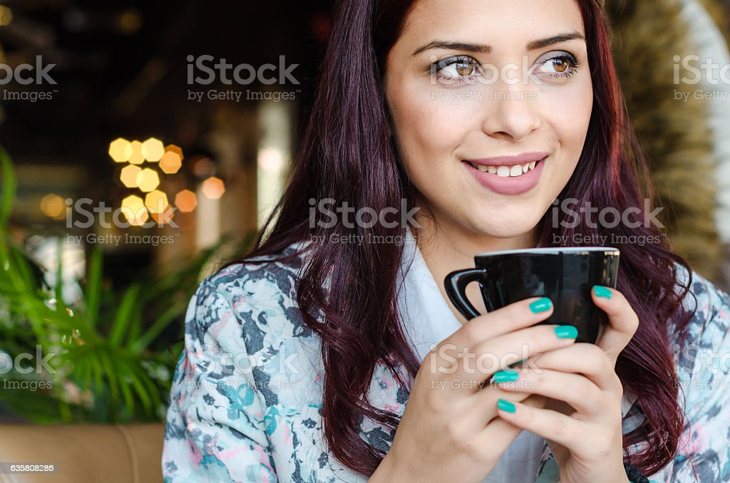 portrait of a beautiful teenage girl with coffee stock photo