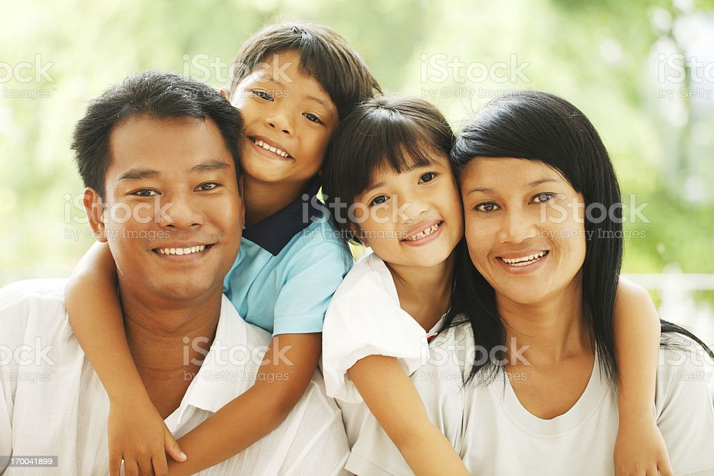 Portrait of a beautiful Thai family. stock photo