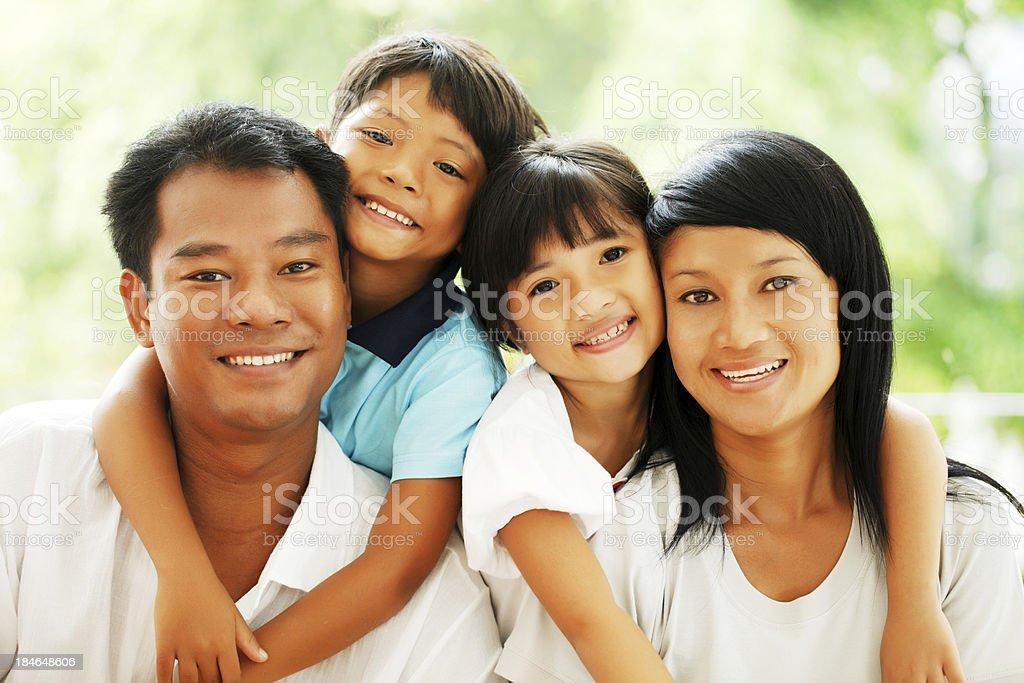 Portrait of a beautiful Thai family. stock photo