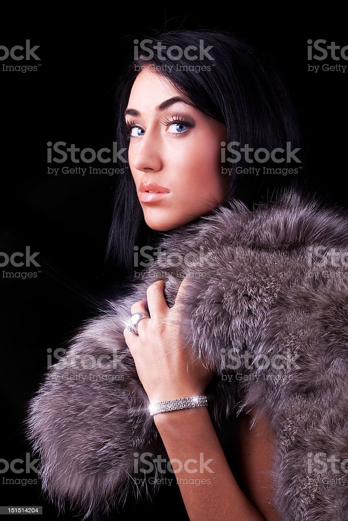 Portrait of a beautiful woman holding coat royalty-free stock photo