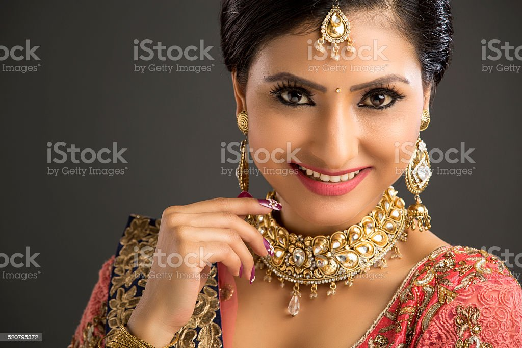 Portrait of a beautiful woman in glamorous outfit and jewellery stock photo