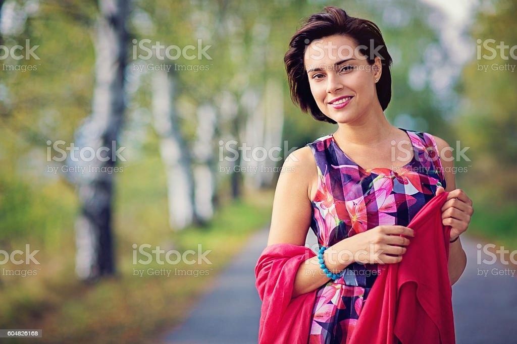 Portrait of a beautiful woman in the autumn forest stock photo