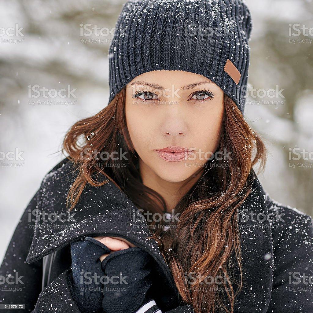 Portrait of a beautiful woman in winter stock photo