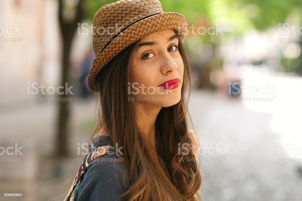 Portrait of a beautiful woman looking at camera. stock photo