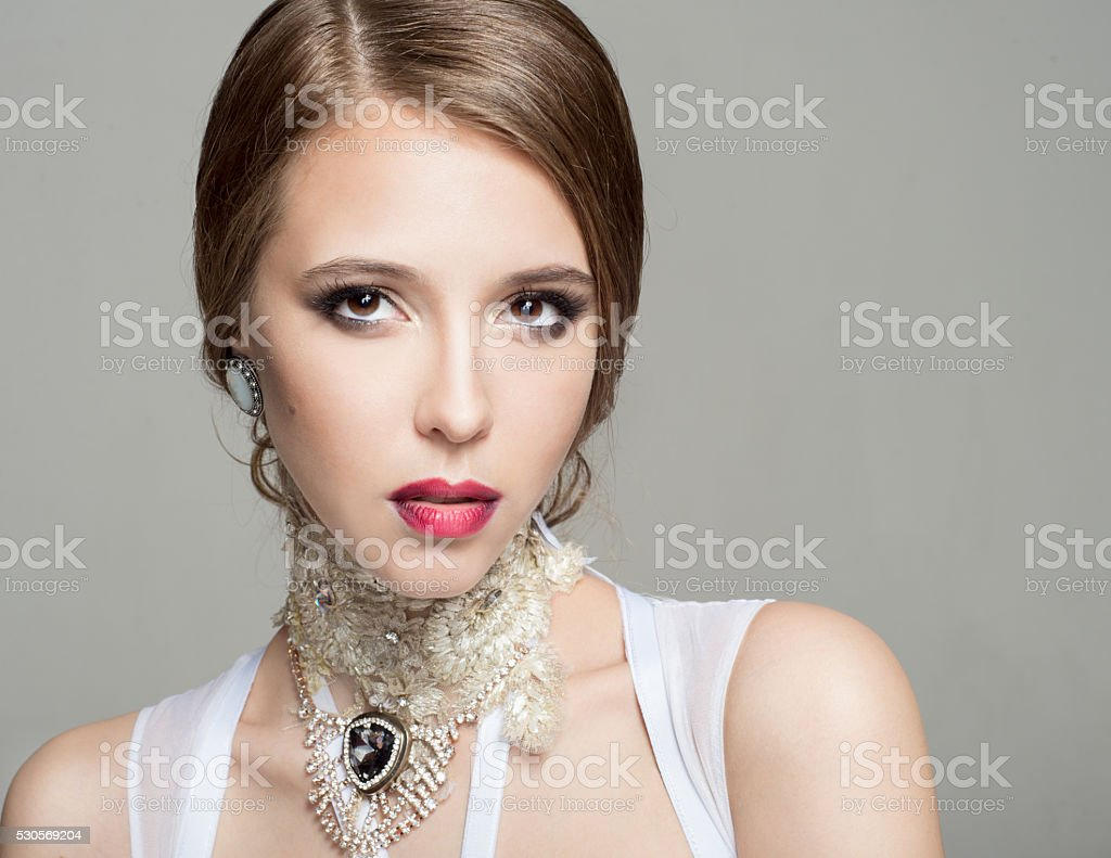 Portrait of a beautiful woman on a gray background stock photo