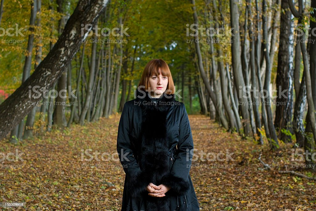 Portrait of a beautiful woman on the alley royalty-free stock photo