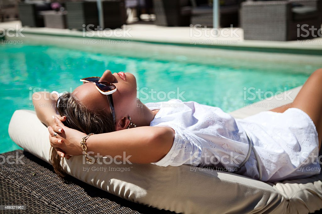 Portrait of a beautiful woman on vacation in luxury resort stock photo