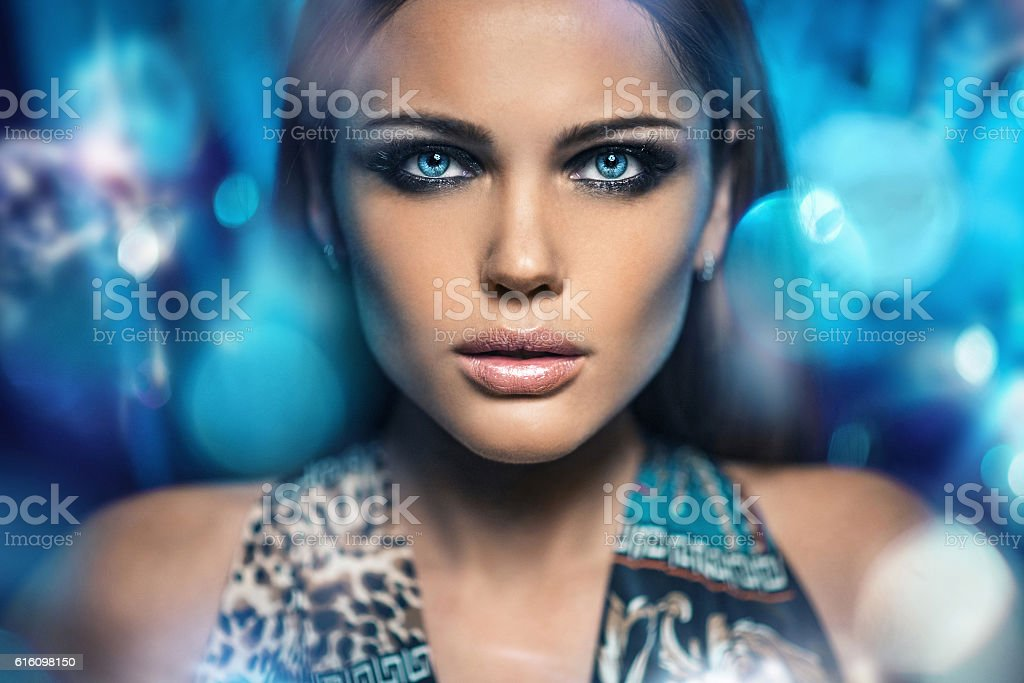 Portrait of a beautiful woman over bright night lights stock photo