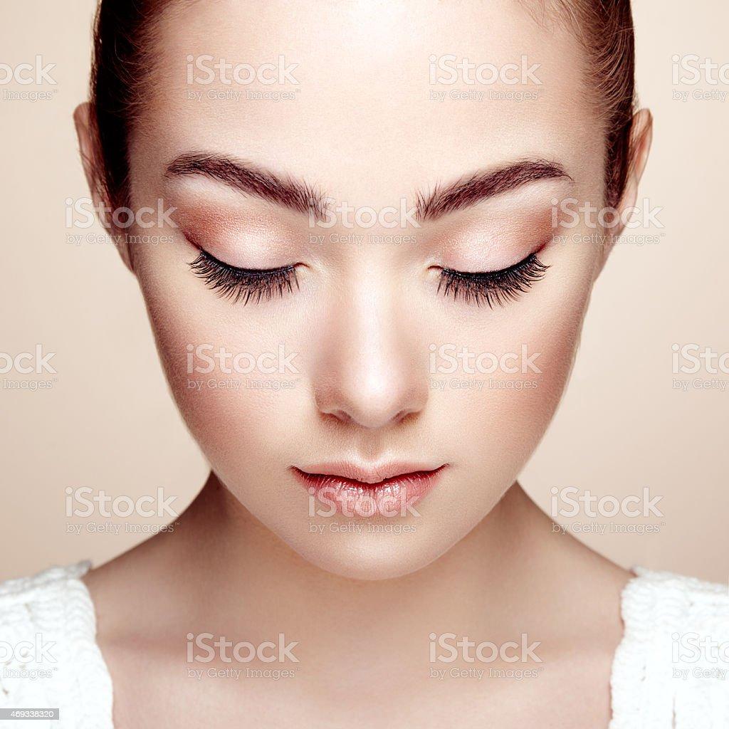 A portrait of a beautiful woman wearing a perfect make up stock photo