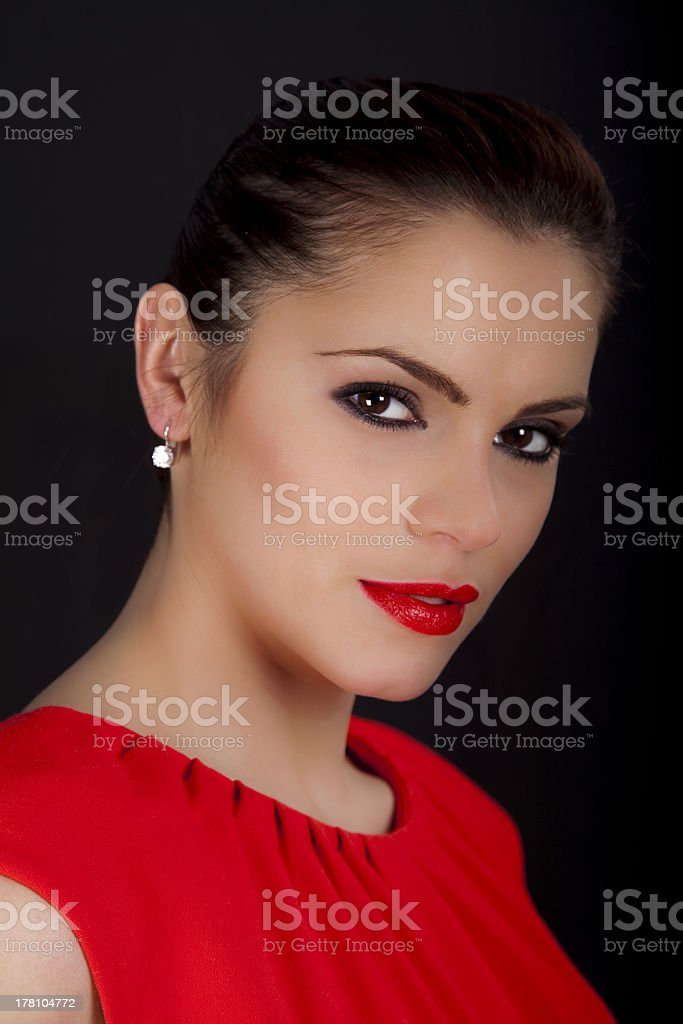 Portrait of a beautiful woman wearing red dress royalty-free stock photo